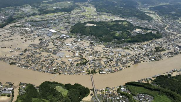 An aerial view shows flooded Kuma River caused by a heavy rain at a residential area in Hitoyoshi, Japan