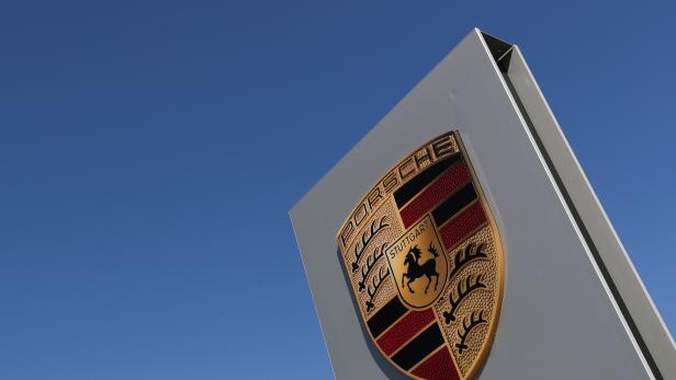A logo of Porsche is seen outside a Porsche car dealer, amid the coronavirus disease (COVID-19) outbreak in Brussels