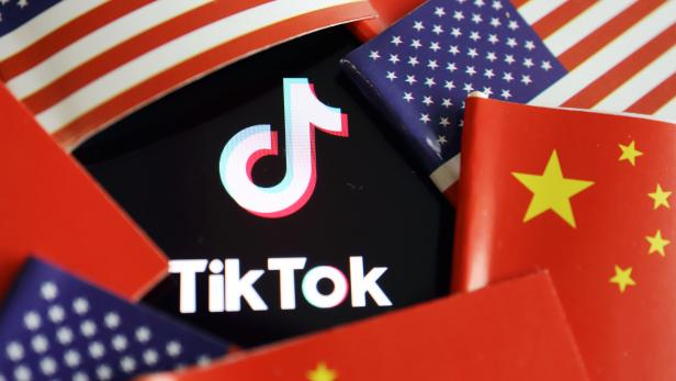 Illustration picture of Tiktok with U.S. and Chinese flags