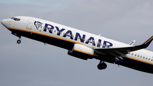 FILE PHOTO: FILE PHOTO: A Ryanair plane takes off from Manchester Airport as the spread of the coronavirus disease (COVID-19) continues in Manchester