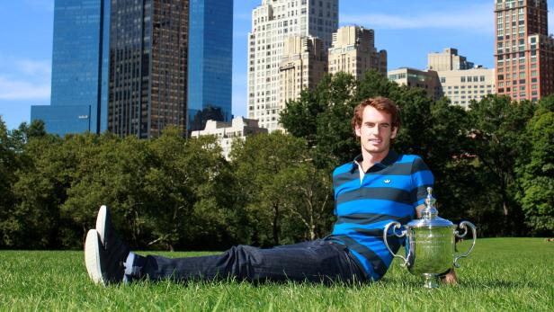 FILE PHOTO: Britain's Andy Murray poses with U.S. Open trophy in Central Park New York September 11, 2012
