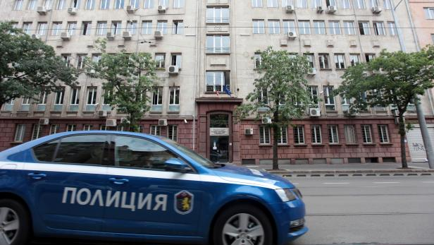 A police car passes past Bulgaria's National Revenue Agency building in Sofia