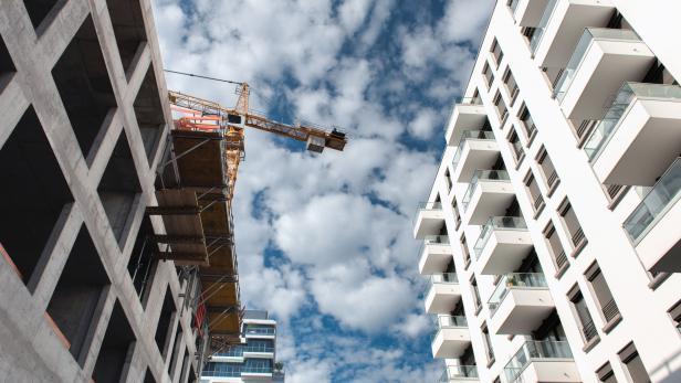 crane among modern buildings in Berlin