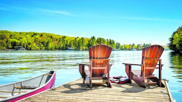 Muskoka chairs on a wooden dock