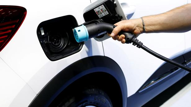 FILE PHOTO: The charging plug of a Renault Captur E-Tech Hybrid car is seen at Brussels Motor Show