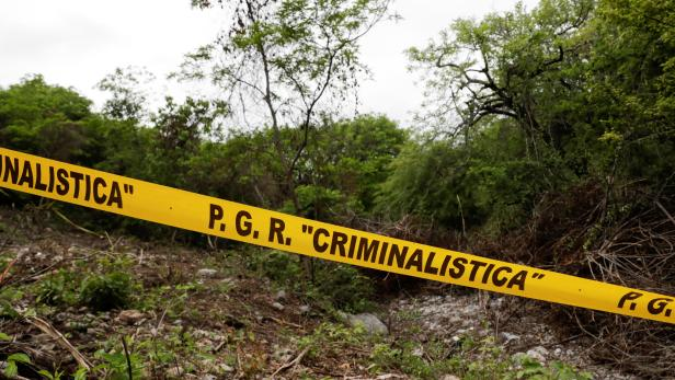 Yellow police tape is seen at the Barranca del Carnicero (Butcher's Ravine) where the remains of one of the 43 missing students from Ayotzinapa were found, at the mountain town of Cocula