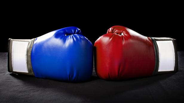 Red and Blue Boxing Gloves on a Black Background