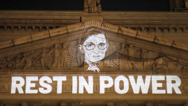 An image of Associate Justice of the Supreme Court of the United States Ruth Bader Ginsburg is projected onto the New York State Civil Supreme Court building in Manhattan, New York City, U.S. after she passed away