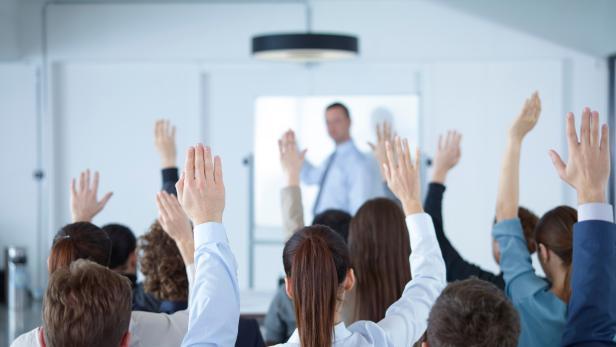 Businessman giving presentation at meeting
