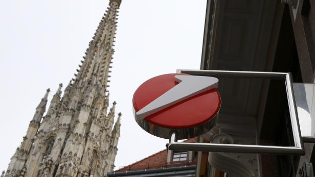 The logo of UniCredit, Italy's biggest bank by assets, is pictured next to a spire St. Stephen's cathedral at a UniCredit unit Bank Austria branch office in Vienna