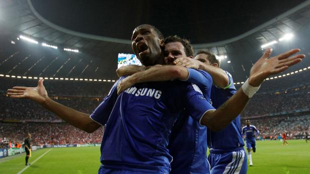 FILE PHOTO:  Chelsea players celebrate Didier Drogba's late equaliser in the Champions League final against Bayern Munich at the Allianz Arena in Munich.