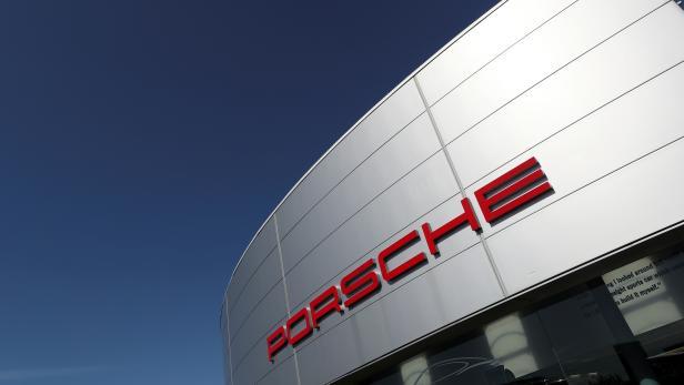 FILE PHOTO: A logo of Porsche is seen outside a Porsche car dealer in Brussels