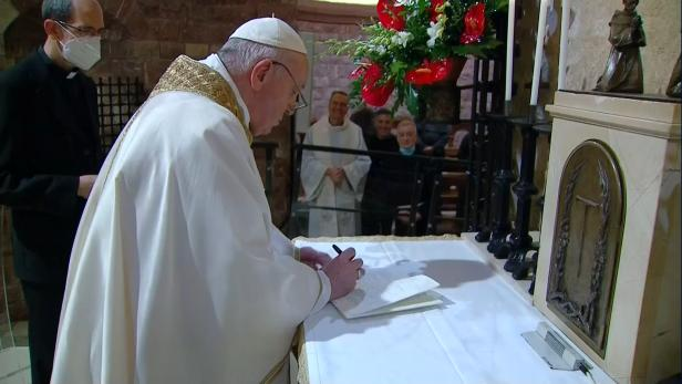 Pope Francis signs his latest encyclical in Assisi