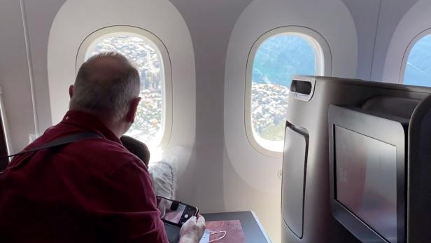 Passengers look out of a plane window during Qantas Great Southern Land scenic flight in Australia