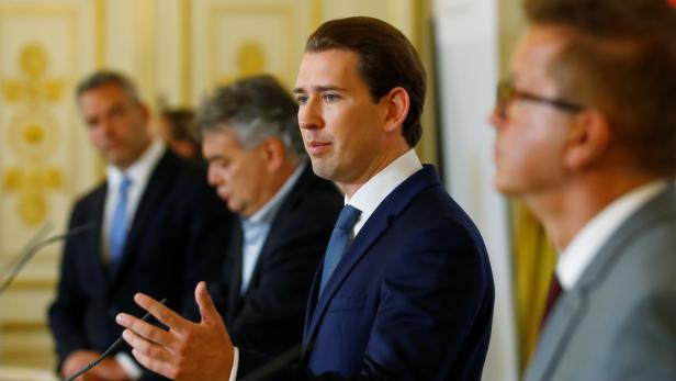 Austria's Chancellor Kurz, Vice Chancellor Kogler, Interior Minister Nehammer and Health Minister Anschober address the media in Vienna