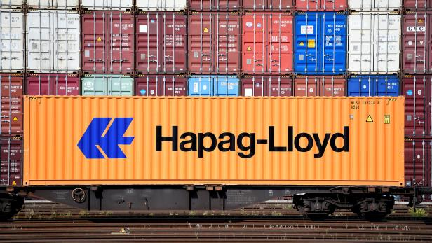 FILE PHOTO: A Hapag-Lloyd container is pictured at a loading terminal in the port of Hamburg