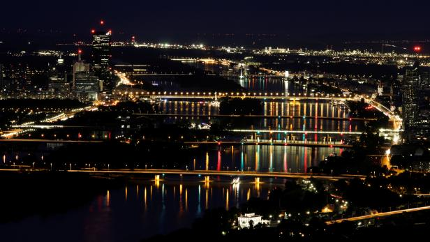 A long time exposure shows a night view of the Danube river from Leopoldsberg in Vienna