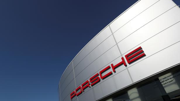 FILE PHOTO: A logo of Porsche is seen outside a Porsche car dealer in Brussels