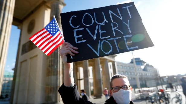 """Demonstrators attend the """"Count the Votes! Rally for Fair Elections in the USA"""" organized by Young Democrats Abroad, in Berlin"""