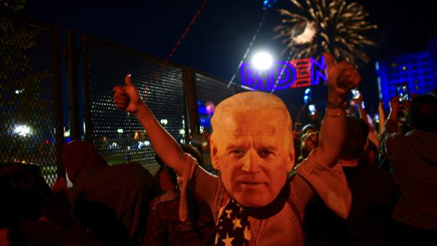Supporters celebrate during U.S. President-elect Joe Biden's victory speech in Wilmington