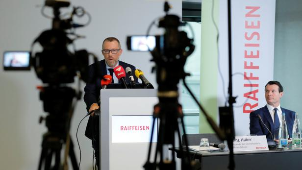 President Guy Lachappelle is seen as CEO Heinz Huber of Swiss Raiffeisen Schweiz bank addresses the annual news conference in Zurich