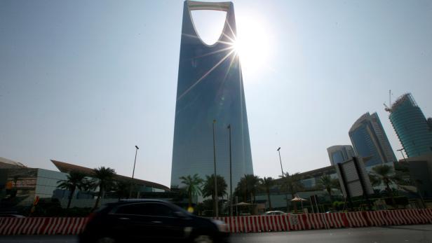 FILE PHOTO: A car drives past the Kingdom Centre Tower in Riyadh