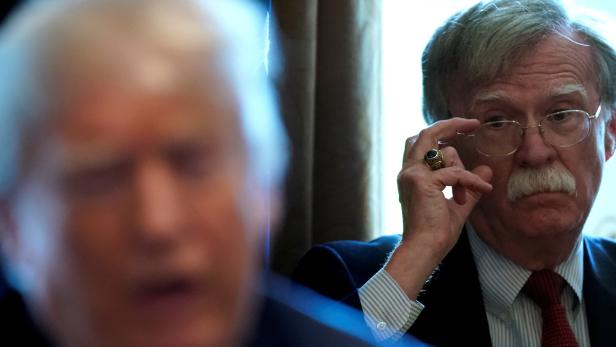 FILE PHOTO: Bolton listens as Trump holds a cabinet meeting at the White House in Washington