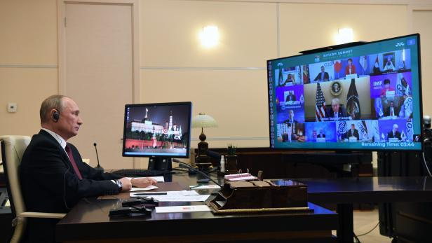 Russian President Vladimir Putin takes part in a virtual G20 summit
