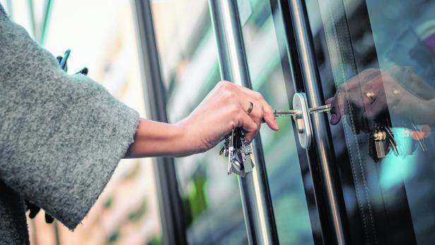 Unlocking door with a key.