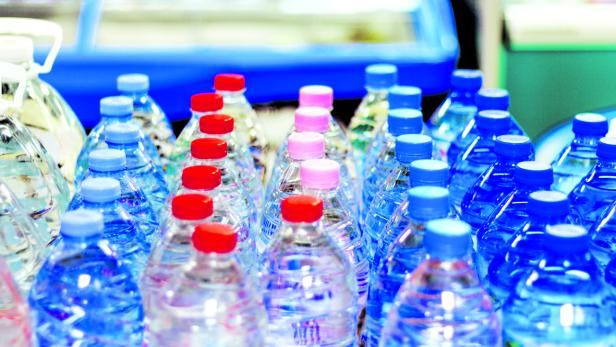 colorful caps on plastic bottles with water