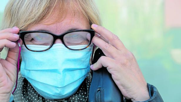 Woman with misted glasses due to protective mask