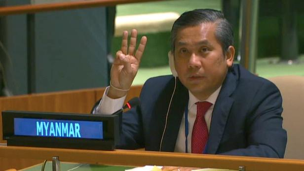 Myanmar's ambassador to the United Nations Kyaw Moe Tun holds up three fingers at the end of his speech in New York