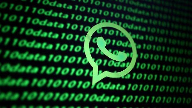 FILE PHOTO: The Whatsapp logo and binary cyber codes are seen in this illustration