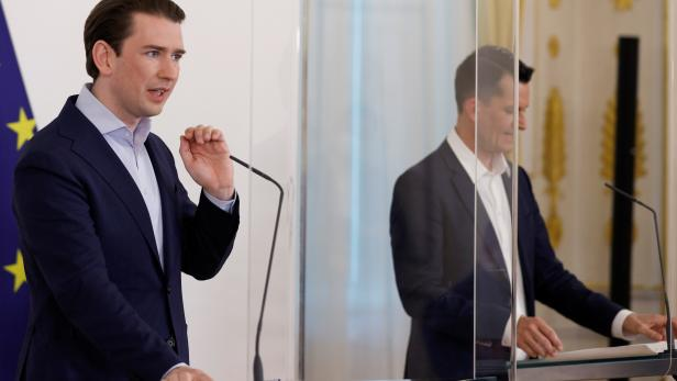Austrian Chancellor Kurz and Health Minister Mueckstein attend a news conference in Vienna