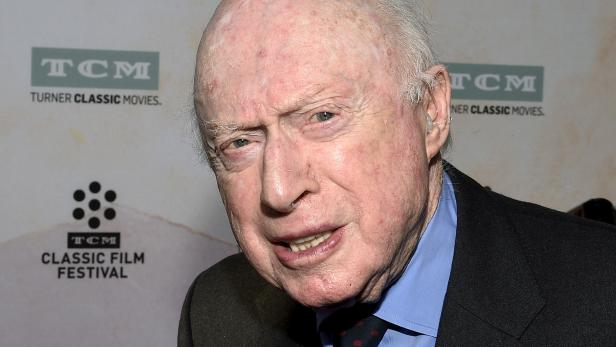 """FILE PHOTO: Actor Norman Lloyd poses during 50th anniversary screening of musical drama film """"The Sound of Music"""" at the opening night gala of the 2015 TCM Classic Film Festival in Los Angeles"""