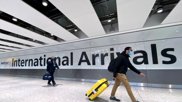 FILE PHOTO: FILE PHOTO: Travellers at Heathrow Airport