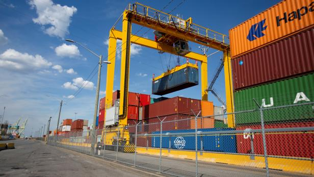 A shipping container is lifted in the Port of Montreal