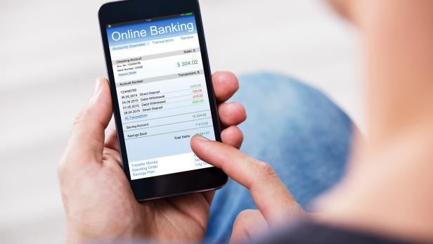 Man Banking Online Using Mobile Phone