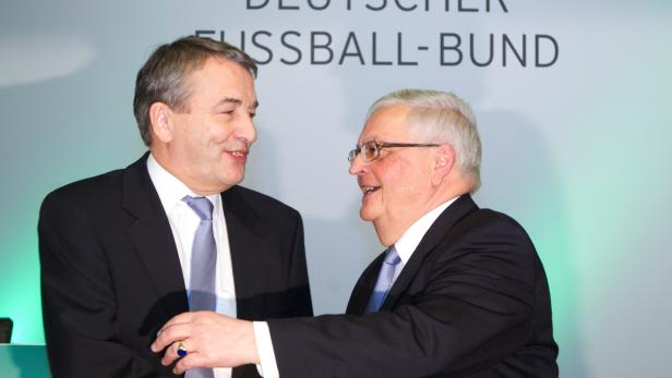 FILE PHOTO: Niersbach, designated DFB president embraces DFB president Zwanziger as they arrive for a general meeting in Frankfurt