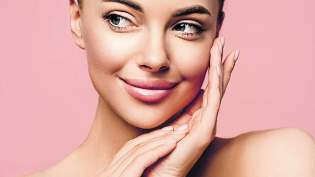 Beautiful young woman with clean fresh skin look away. Girl beauty face care. Facial treatment. Cosmetology, beauty and spa .