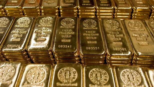 FILE PHOTO: Gold bars of one kilogram are placed on a table at a plant of gold refiner and bar manufacturer Argor-Heraeus SA in the southern Swiss town of Mendrisio