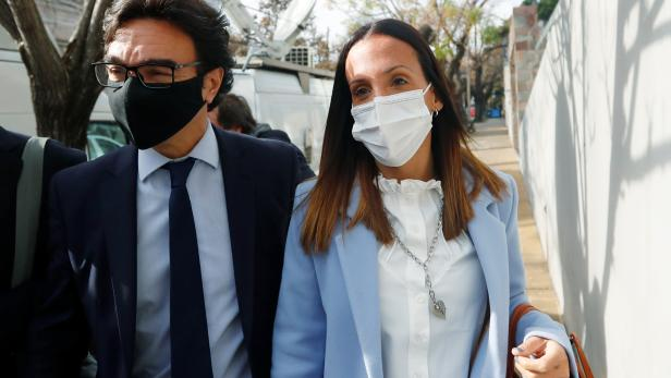 Agustina Cosachov, psychiatrist of late Argentine soccer legend Diego Armando Maradona arrives to a prosecutor's office in San Isidro, accompanied by her lawyer, Vadim Mischanchuk, in Buenos Aires