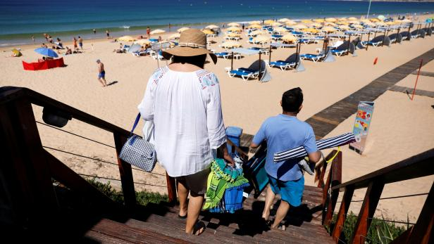 FILE PHOTO: People arrive at Gale beach amid the coronavirus disease (COVID-19) pandemic, in Albufeira