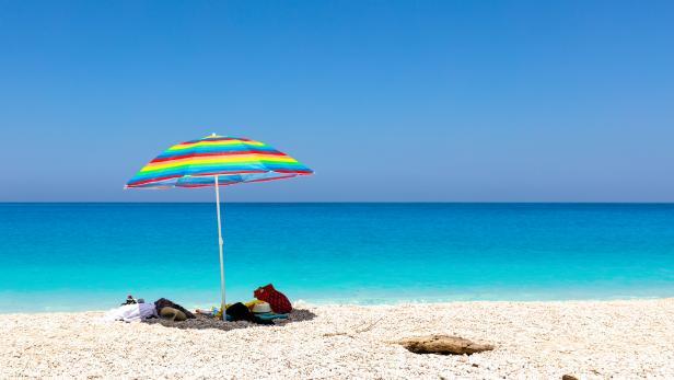 Blue sea, white beach and colorful umbrella
