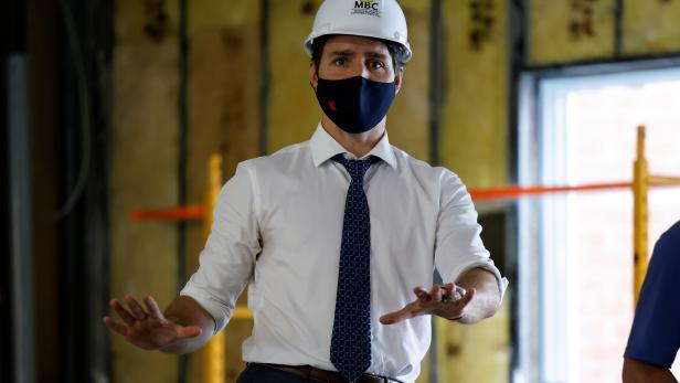 Canada's Prime Minister Justin Trudeau visits a construction site to highlight affordable housing policies in Ottawa