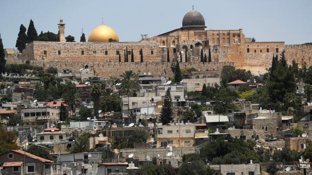 The Dome of the Rock on the compound known to Muslims as Noble Sanctuary and to Jews as Temple Mount, in Jerusalem's Old City, is seen in the background as part of the neighbourhood of Silwan in East Jerusalem is seen in the foreground