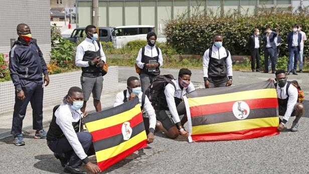 FILE PHOTO : Uganda's Olympic team pose upon arrival at their pre-Olympics camp host town of Izumisano