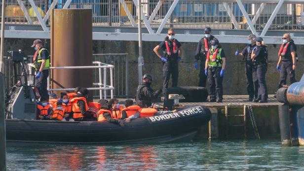 Migrants continue to arrive along Britain's coast seeking asylum