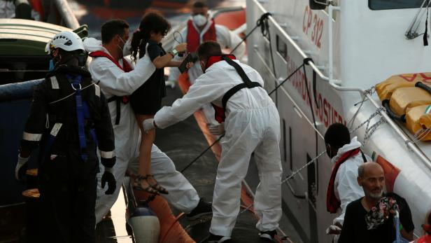 Injured migrants are evacuated by the Italian Coast Guard from the German NGO migrant rescue ship Sea-Watch 3