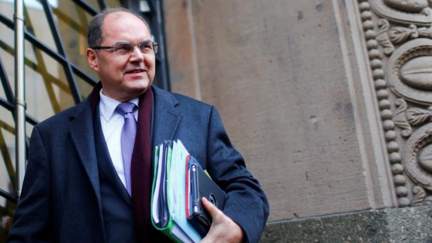 FILE PHOTO: Christian Schmidt Federal Minister of Food and Agriculture arrives for talks to discuss forming a government with the German Social Democratic Party (SPD) in Berlin
